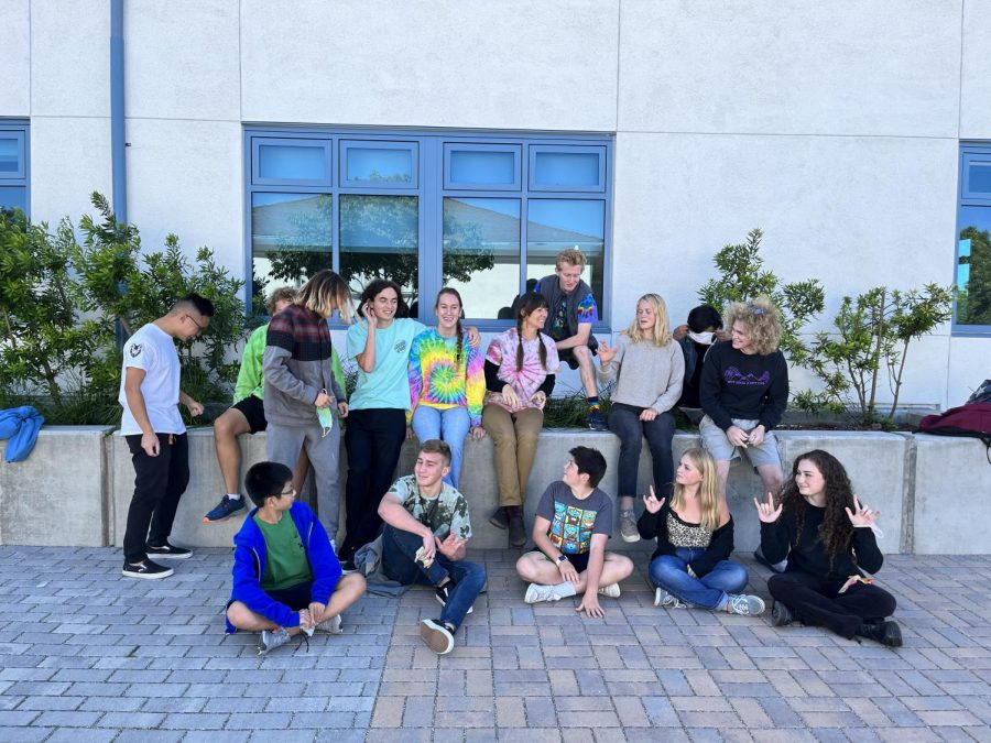 Students and faculty dressed in colorful attire for Tie-Dye Day
